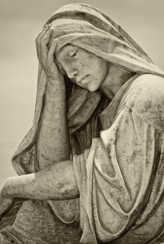 Bigstock-Old-statue-of-a-suffering-woma-26567978